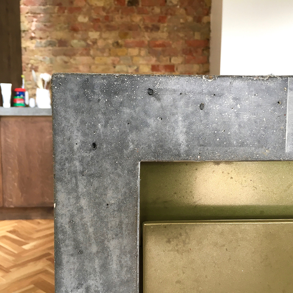 Conscious Forms - penge london large cast insitu polished concrete island with waterfall end brass doors corner detail