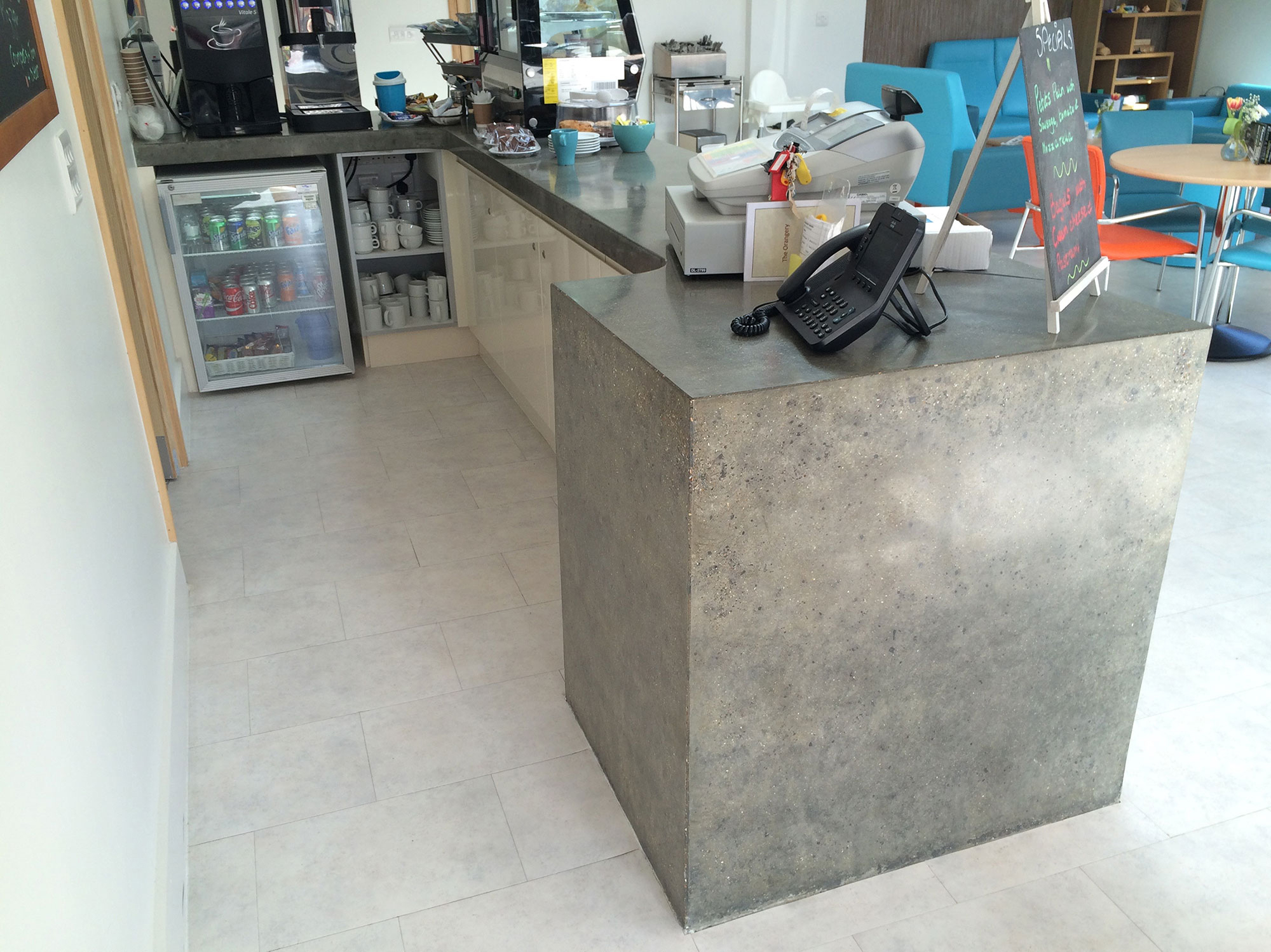 Conscious Forms - st raphaels hospice cheam orangery cafe polished concrete service counter with double waterfall ends standard grey radius internal corners exposed aggregate finish